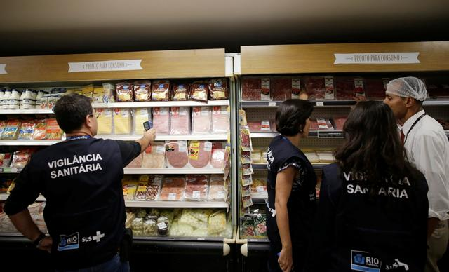 A member of the Public Health Surveillance Agency measures the temperature where the products are exposed, at a supermarket in Rio de Janeiro, Brazil, March 20, 2017. REUTERS/Ricardo Moraes
