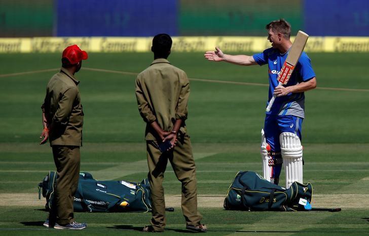 Cricket - India v Australia - Australia team practice session - M Chinnaswamy Stadium, Bengaluru, India - 03/03/17 - Australia's David Warner inspects the pitch ahead of their second test match. REUTERS/Danish Siddiqui/File Photo