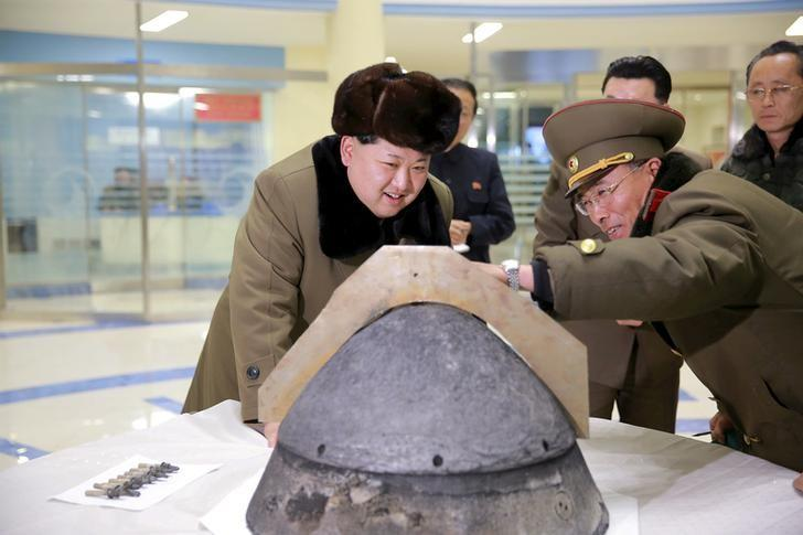 North Korean leader Kim Jong Un looks at a rocket warhead tip after a simulated test of atmospheric re-entry of a ballistic missile, at an unidentified location in this undated file photo released by North Korea's Korean Central News Agency (KCNA) in Pyongyang on March 15, 2016. KCNA/via Reuters/Files