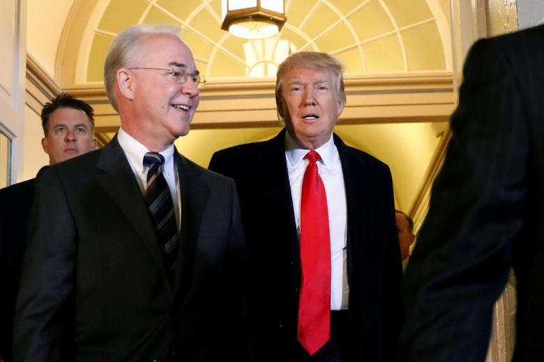 U.S. President Donald Trump (C) and Health and Human Services Secretary Tom Price (L) enter the U.S. Capitol in Washington, U.S., March 21, 2017. REUTERS/Kevin Lamarque