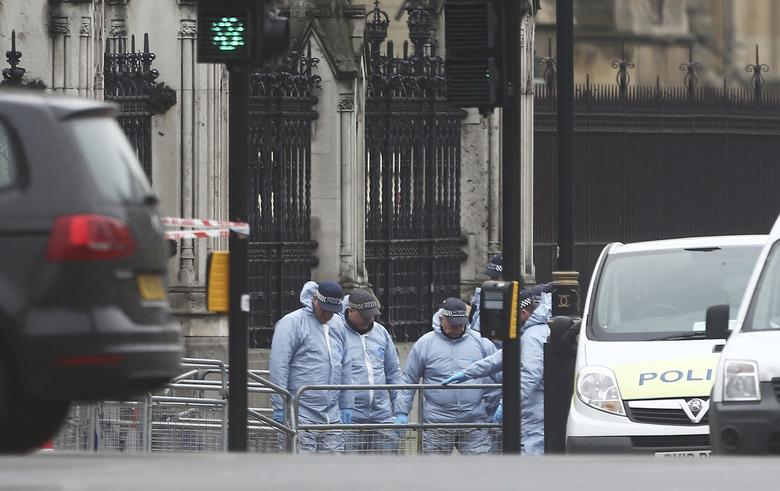 Police work at Carriage Gate outside the Houses of Parliament the morning after an attack by a man driving a car and weilding a knife left five people dead and dozens injured, in London, Britain, March 23, 2017. REUTERS/Neil Hall