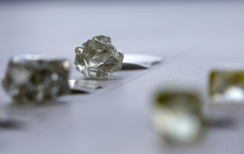 FILE PHOTO: Diamonds are displayed during a visit to the De Beers Global Sightholder Sales (GSS) in the capital Gaborone in Botswana, November 24, 2015. REUTERS/Siphiwe Sibeko/File Photo