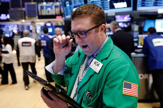 A trader works on the floor of the New York Stock Exchange (NYSE) shortly after the opening bell in New York, U.S., March 22, 2017.  REUTERS/Lucas Jackson