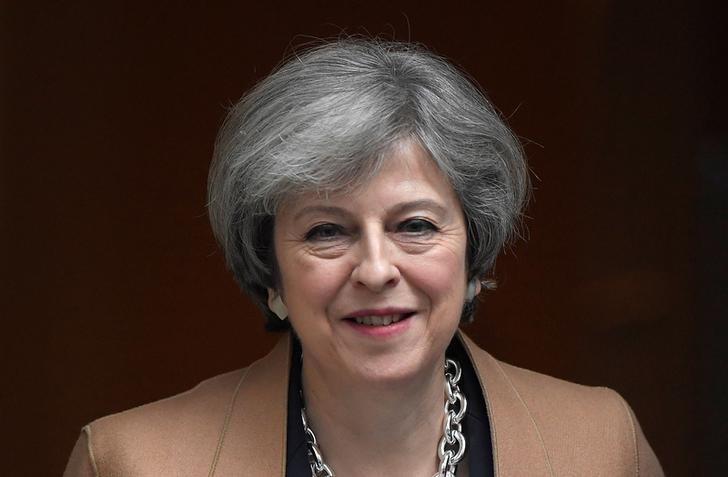 FILE PHOTO: Britain's Prime Minister Theresa May leaves Downing Street in London, Britain, March 15, 2017.     REUTERS/Toby Melville/File Photo