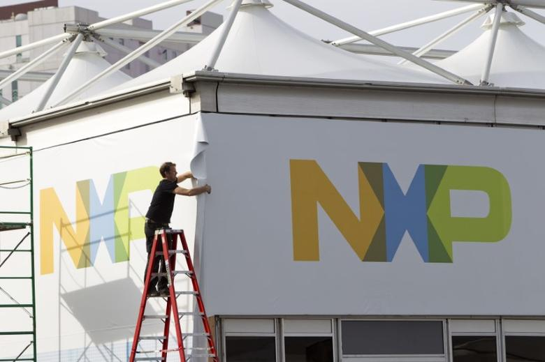 A man works on a tent for NXP Semiconductors in preparation for the 2015 International Consumer Electronics Show (CES) at Las Vegas Convention Center in Las Vegas, Nevada, U.S. on January 4, 2015.   REUTERS/Steve Marcus/File Photo
