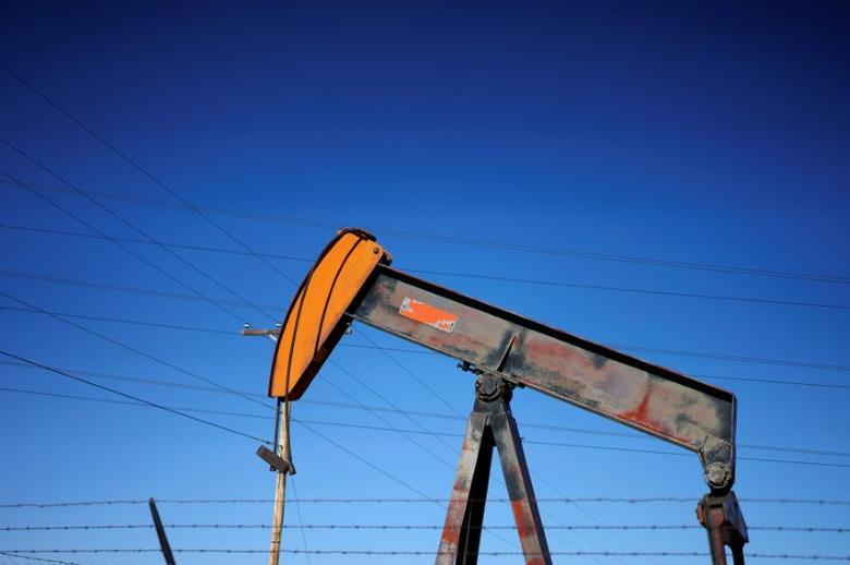 An oil well pump jack is seen at an oil field supply yard near Denver, Colorado, U.S., February 2, 2015.    REUTERS/Rick Wilking/File Photo