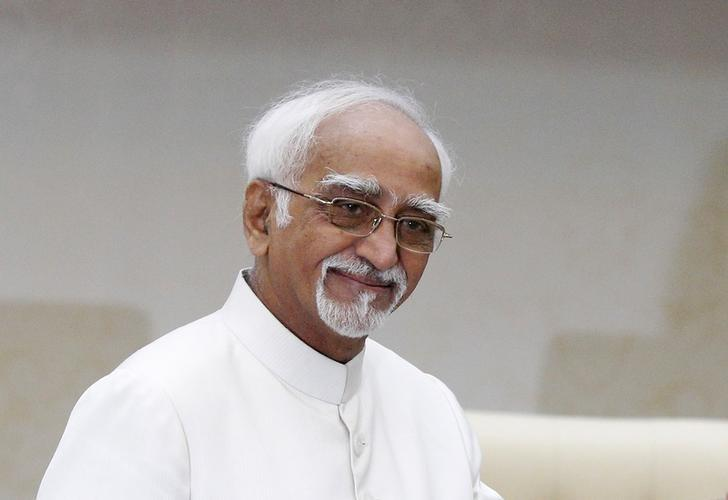 Vice President Mohammad Hamid Ansari smiles before a meeting with Cambodia's Prime Minister Hun Sen at the Prime Minister's office in Phnom Penh September 16, 2015. REUTERS/Samrang Pring/Files