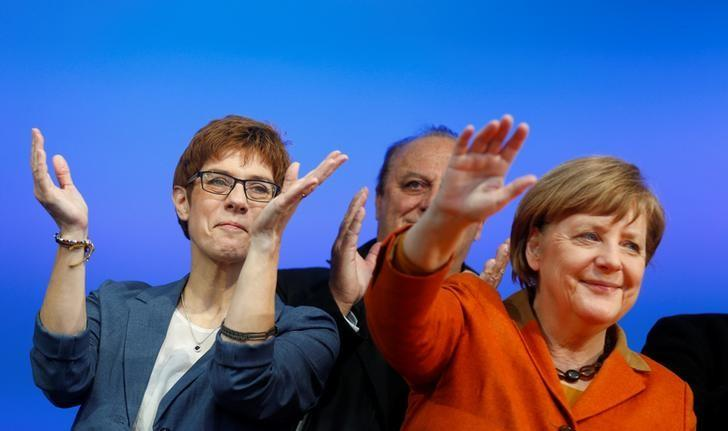 Annegret Kramp-Karrenbauer (L), State Minister-President and top candidate of the Christian Democratic Union Party (CDU) and German Chancellor Angela Merkel attend an election rally for the upcoming state elections in the Saarland in St. Wendel near Saarbruecken, Germany March 23, 2017. REUTERS/Ralph Orlowski