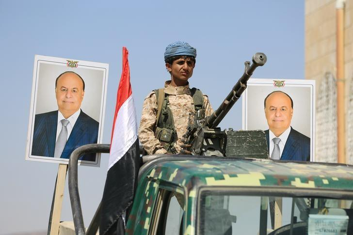 A police trooper mans a machine gun mounted on a patrol truck securing a street where people loyal to Yemen's President Abd-Rabbu Mansour Hadi demonstrated to show support to Hadi in the country's northern city of Marib November 3, 2016. REUTERS/Ali Owidha/Files