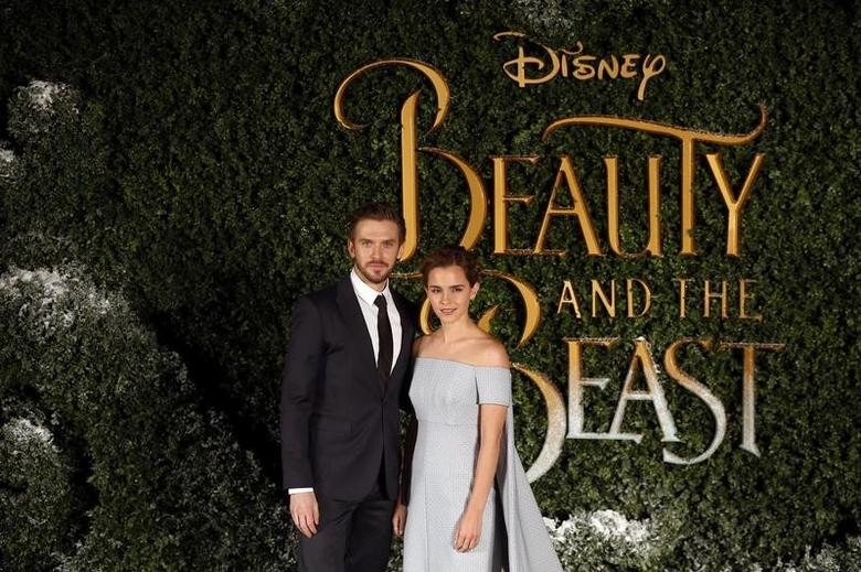 Actors Dan Stevens (L) and Emma Watson pose for photographers at a media event for the film Beauty and the Beast in London, Britain February 23, 2017. REUTERS/Neil Hall