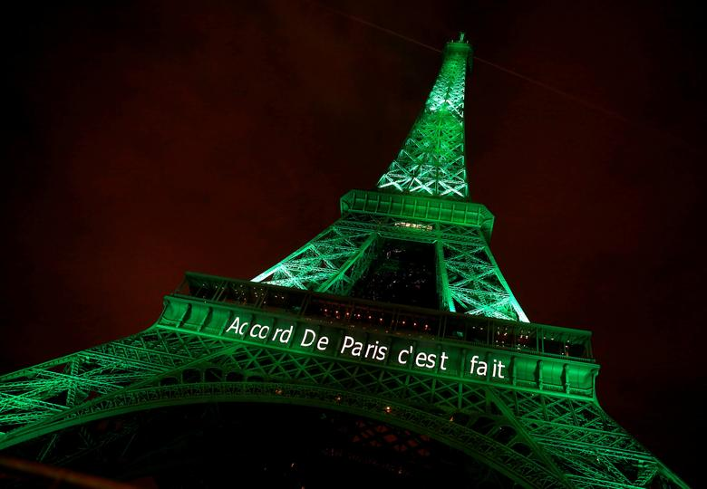 The Eiffel tower is illuminated in green with the words ''Paris Agreement is Done'', to celebrate the Paris U.N. COP21 Climate Change agreement.    REUTERS/Jacky Naegelen