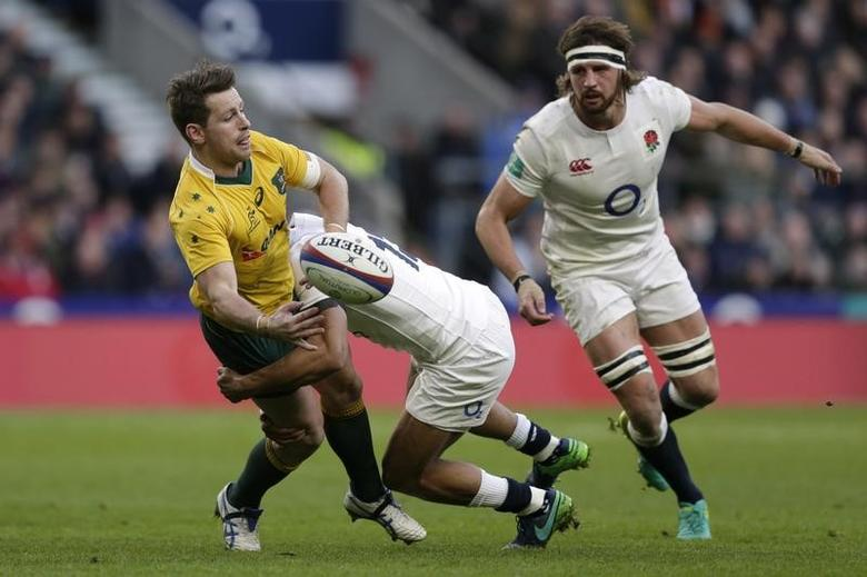FILE PHOTO: Britain Rugby Union - England v Australia - 2016 Old Mutual Wealth Series - Twickenham Stadium, London, England - 3/12/16 Australia's Bernard Foley is tackled by England's Owen Farrell  Action Images via Reuters / Henry Browne Livepic