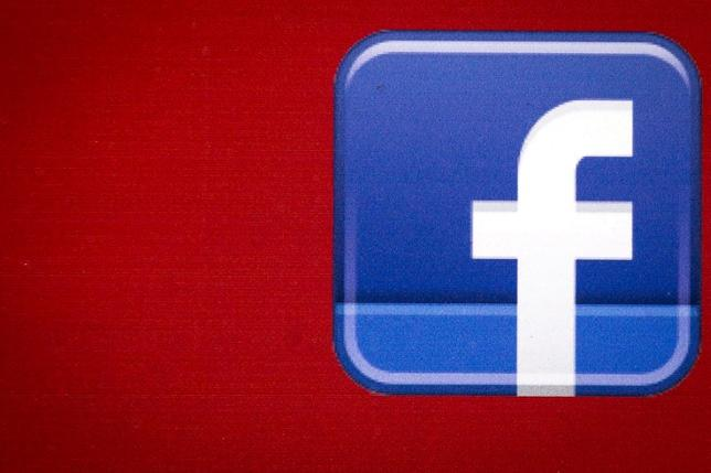 FILE PHOTO -  A Facebook logo is displayed on the side of a tour bus in New York's financial district July 28, 2015. REUTERS/Brendan McDermid/File Photo                  C
