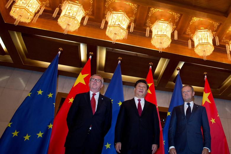 FILE PHOTO: From left, European Commission President Jean-Claude Juncker, Chinese President Xi Jinping and European Council President Donald Tusk pose for photos before a meeting held at the Diaoyutai State Guesthouse in Beijing, China, Tuesday, July 12, 2016. REUTERS/Ng Han Guan/Pool/File Photo