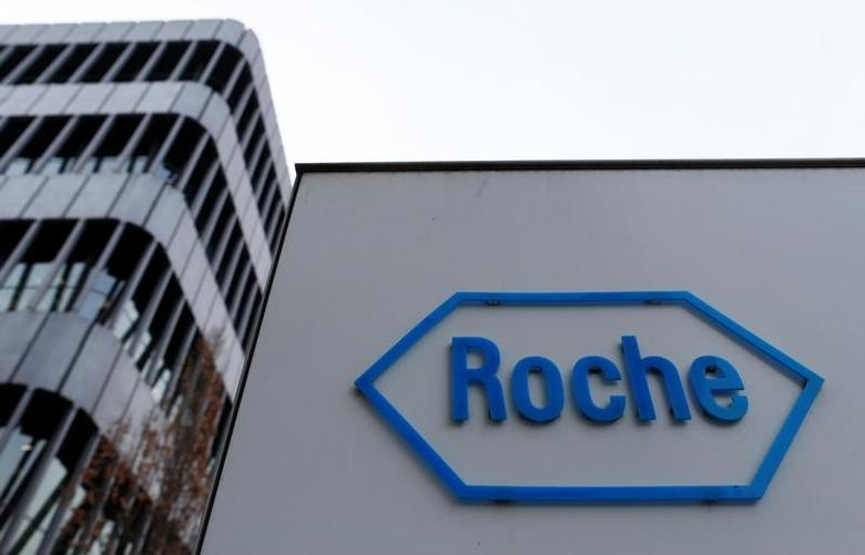 The logo of Swiss pharmaceutical company Roche is seen outside their headquarters in Basel, January 30, 2014. REUTERS/Ruben Sprich/File Photo