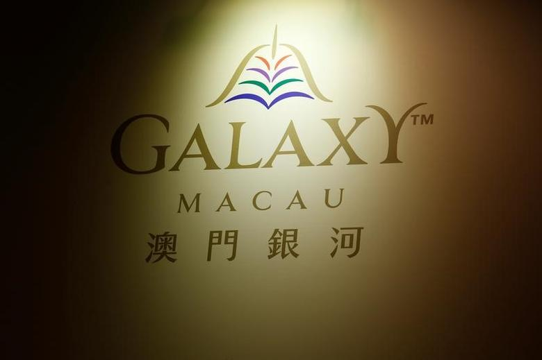 A logo of Galaxy Macau, part of the Galaxy Entertainment Group (GEG), is displayed at a news conference on the gaming resort's results in Hong Kong, China February 28, 2017.      REUTERS/Bobby Yip - RTS10QN3