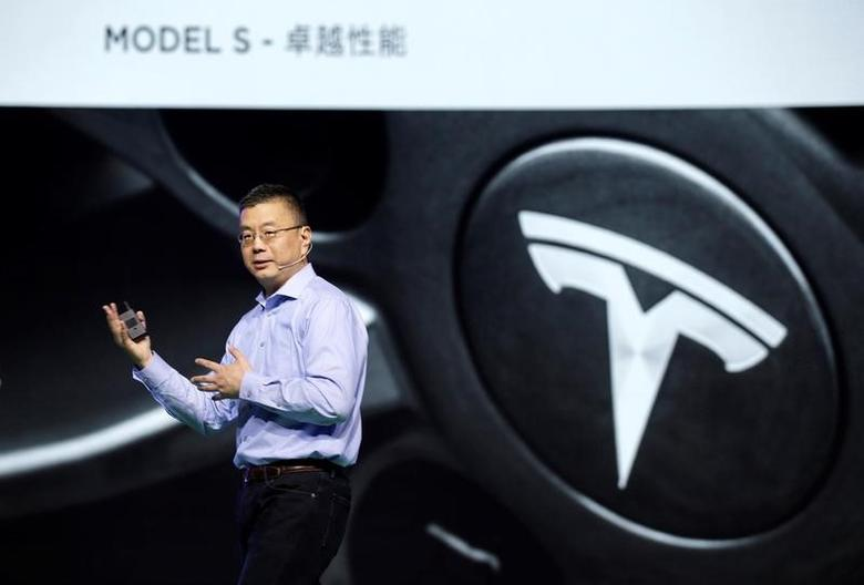 Robin Ren, Vice President of Tesla Motors, delivers a speech at the Global Mobile Internet Confrence (GMIC) in Beijing, China, April 28, 2016. REUTERS/Jason Lee