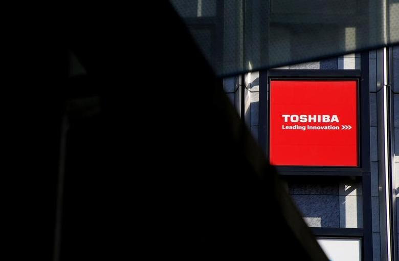 FILE PHOTO: A logo of Toshiba Corp is seen outside an electronics retail store in Tokyo, Japan, February 14, 2017.      REUTERS/Toru Hanai/File Photo