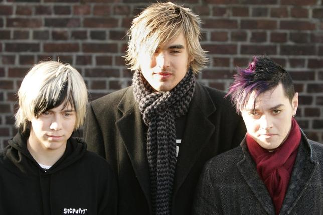 James (L), Charlie and Matt (R) who form the British rock band Busted arrive for the Band Aid 20 recording at Air Studios in London, November 14, 2004.  REUTERS/Peter Macdiarmid