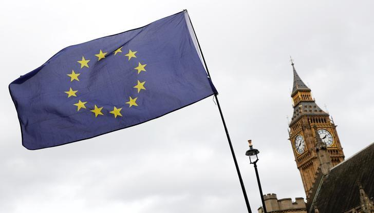 A European Union flag is waved in front of Big Ben outside Parliament after Britain's Prime Minister Theresa May triggered the process by which the United Kingdom will leave the European Union in London, March 28, 2017. REUTERS/Stefan Wermuth