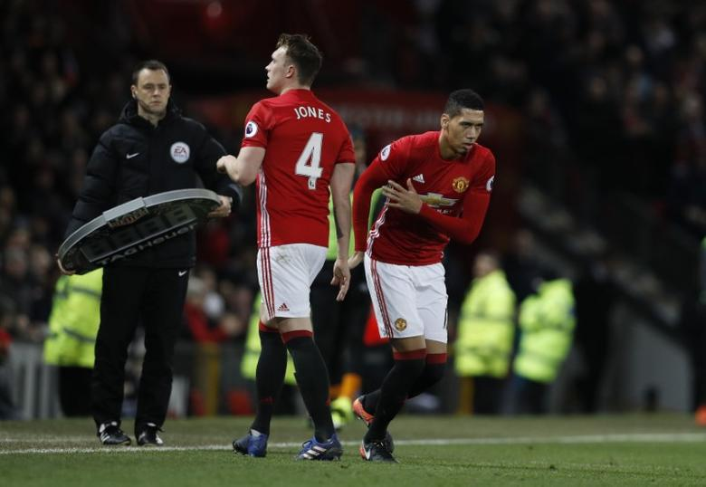 Britain Soccer Football - Manchester United v Hull City - Premier League - Old Trafford - 1/2/17 Manchester United's Chris Smalling comes on as a substitute to replace Phil Jones Reuters / Phil Noble Livepic