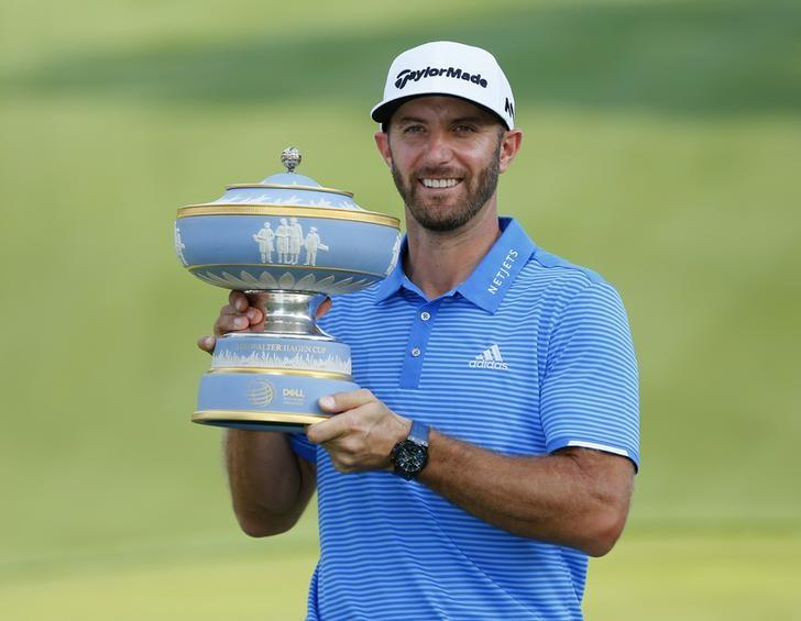Mar 26, 2017; Austin, TX, USA; Dustin Johnson of the United States holds up The Walter Hagen Trophy after beating Jon Rahm of Spain in the final round of the World Golf Classic - Dell Match Play golf tournament  at Austin Country Club. Mandatory Credit: Erich Schlegel-USA TODAY Sports
