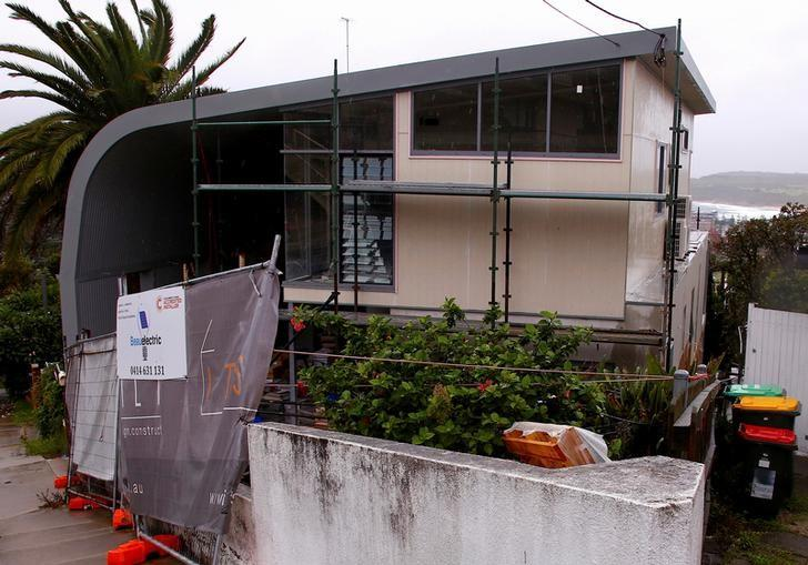 A make-shift fence can be seen out the front of a property being redeveloped which has been registered by Cambridge Analytica as their Australian office in the Sydney beachfront suburb of Maroubra in Australia, March 30, 2017. REUTERS/David Gray