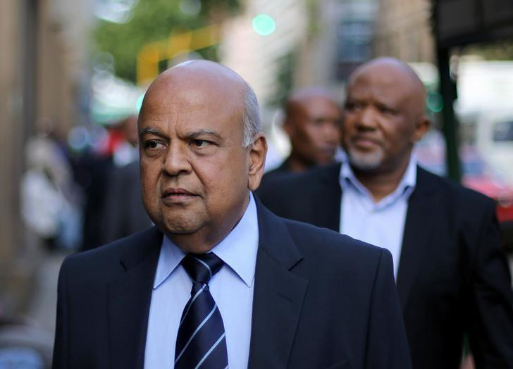 South Africa's Finance Minister Pravin Gordhan walks with his deputy, Mcebisi Jonas as they walk from their offices to a court hearing in Pretoria, South Africa, March 28,2017. REUTERS/Siphiwe Sibeko