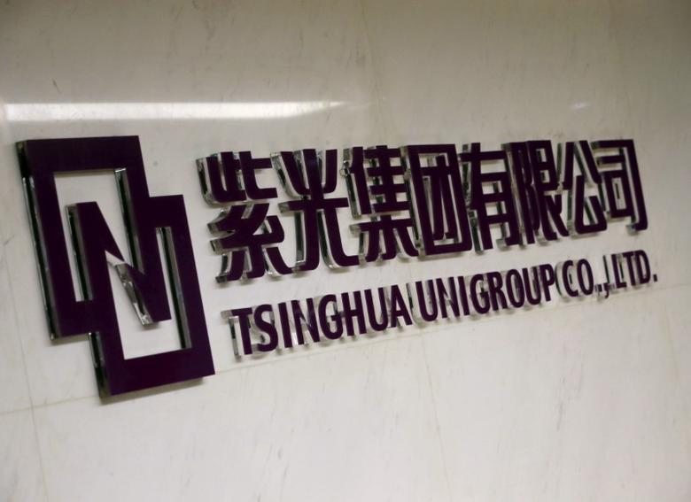 The logo of Tsinghua Unigroup is seen at its office in Beijing, China, November 15, 2015. REUTERS/Kim Kyung-Hoon/File Photo