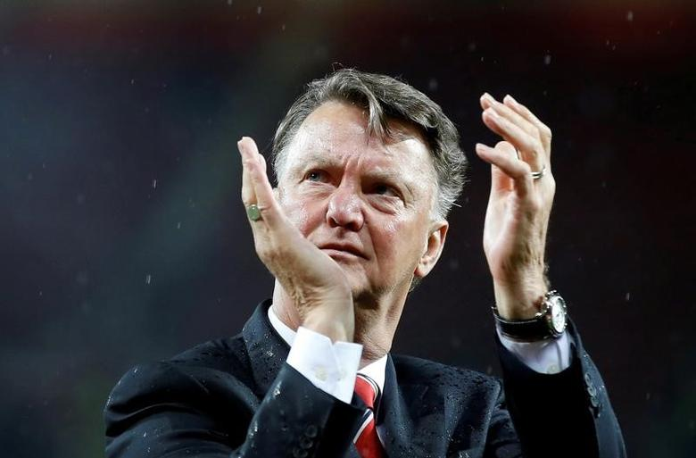Britain Football Soccer - Manchester United v AFC Bournemouth - Barclays Premier League - Old Trafford - 17/5/16 Manchester United manager Louis van Gaal applauds fans during a lap of honour after the game. Action Images via Reuters/Carl Recine Livepic/File Photo