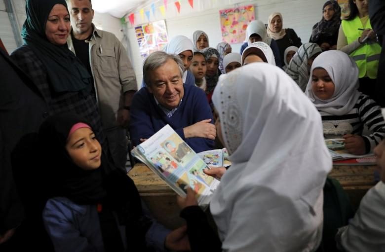 United Nations Secretary General Antonio Guterres (C) speaks to Syrian refugees during his visit to Al Zaatari refugee camp in the Jordanian city of Mafraq, near the border with Syria March 28, 2017. REUTERS/Ammar Awad