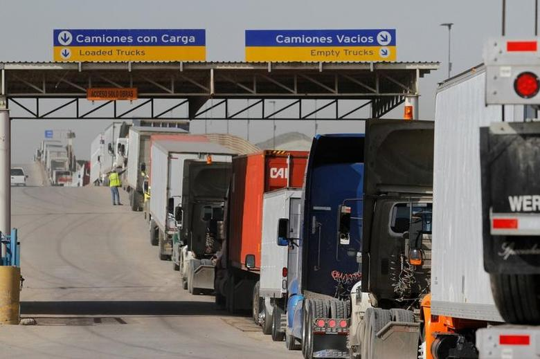 FILE PHOTO - Trucks wait in a long queue for border customs control to cross into the U.S. at the Otay border crossing in Tijuana, Mexico on February 2, 2017. REUTERS/Jorge Duenes/File Photo