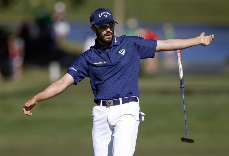 Adam Hadwin drops his putter in reaction to a nearly missed birdie putt on the 14th hole during the final round of  the Arnold Palmer Invitational golf tournament at Bay Hill Club & Lodge . Mandatory Credit: Reinhold Matay-USA TODAY Sports