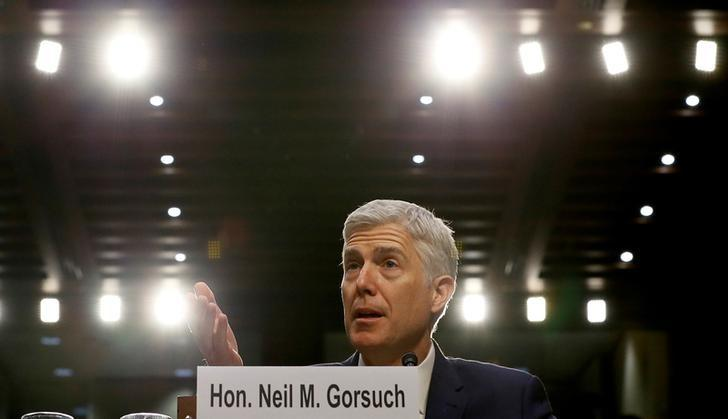 FILE PHOTO: U.S. Supreme Court nominee judge Neil Gorsuch responds to a question as he testifies during the third day of his Senate Judiciary Committee confirmation hearing on Capitol Hill in Washington, U.S. on March 22, 2017. REUTERS/Jim Bourg/File Photo