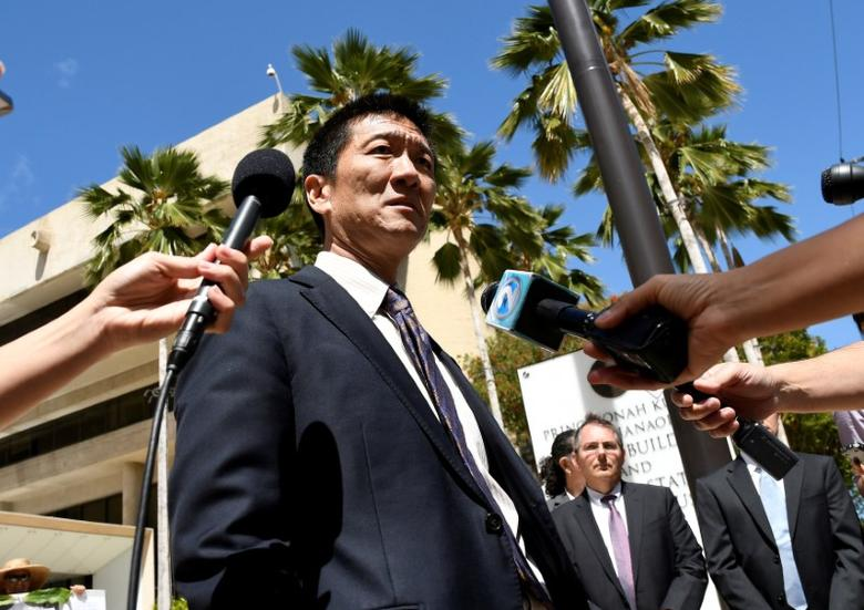 Hawaii Attorney General Douglas Chin talks to the media at the U.S. District Court Ninth Circuit after seeking an extension after filing an amended lawsuit against President Donald Trump's new travel ban in Honolulu, Hawaii, March 29, 2017. REUTERS/Hugh Gentry