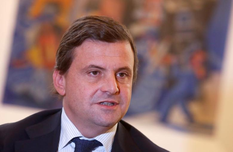 Italian Industry Minister Carlo Calenda talks during an interview with Reuters in his office in Rome, Italy November 25, 2016. REUTERS/Tony Gentile