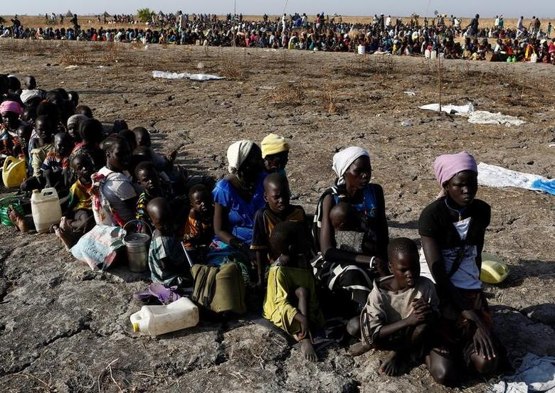 Women and children wait to be registered prior to a food distribution carried out by the United Nations World Food Programme (WFP) in Thonyor, Leer state, South Sudan, February 26, 2017. REUTERS/Siegfried Modola/Files