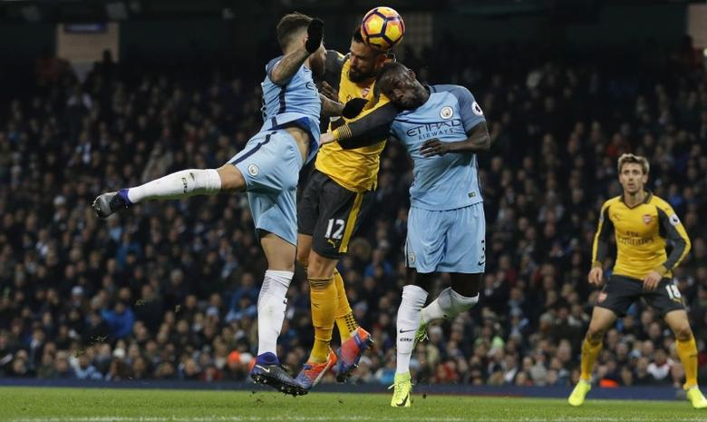 Manchester City v Arsenal - Premier League - Etihad Stadium - 18/12/16 Arsenal's Olivier Giroud in action with Manchester City's Bacary Sagna and Nicolas Otamendi  Reuters / Phil Noble Livepic