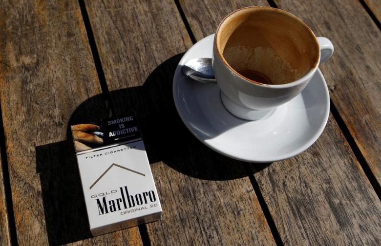 FILE PHOTO: A Marlboro cigarettes pack, a brand of Philip Morris Tobacco, lies next to an empty coffee cup at a cafe in central Sydney June 27, 2011.  REUTERS/Daniel Munoz/File Photo