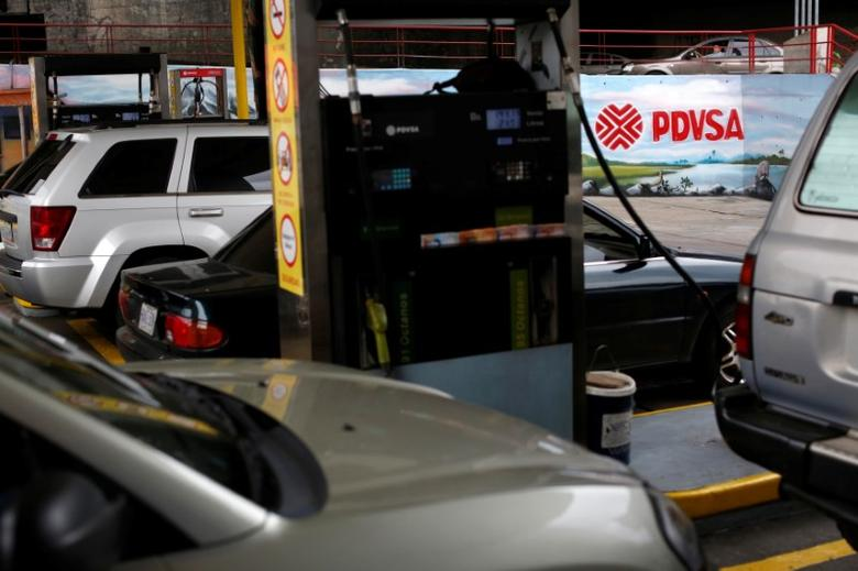 The corporate logo of the state oil company PDVSA is seen in a gas station in Caracas, Venezuela March 23, 2017. REUTERS/Carlos Garcia Rawlins