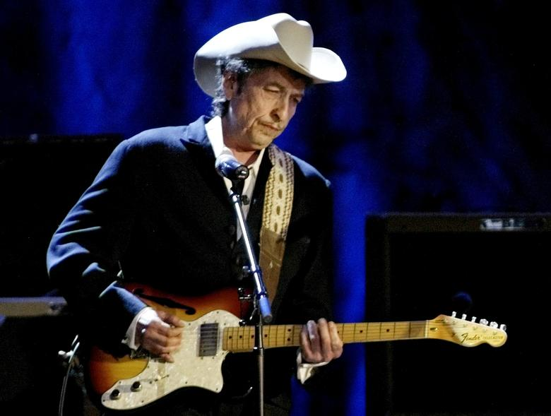 FILE PHOTO: Rock musician Bob Dylan performs at the Wiltern Theatre in Los Angeles, U.S., May 5, 2004. REUTERS/Rob Galbraith/File Photo