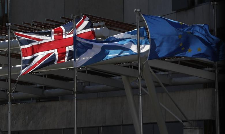 The Union flag,The Scottish Saltire and The European flag fly at the Scottish Parliament in Edinburgh Scotland, Britain March 21, 2017. REUTERS/Russell Cheyne