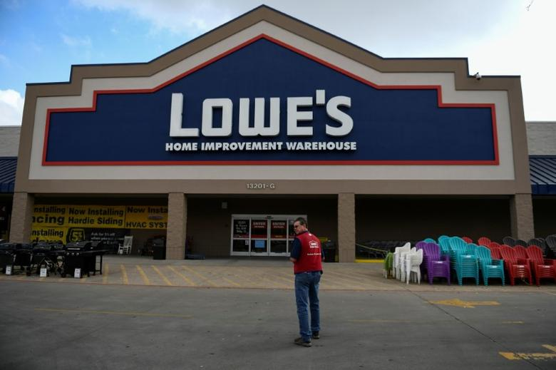 An employee stands outside a Lowe's home improvement chain in Austin, Texas, U.S., February 27, 2017. REUTERS/Mohammad Khursheed