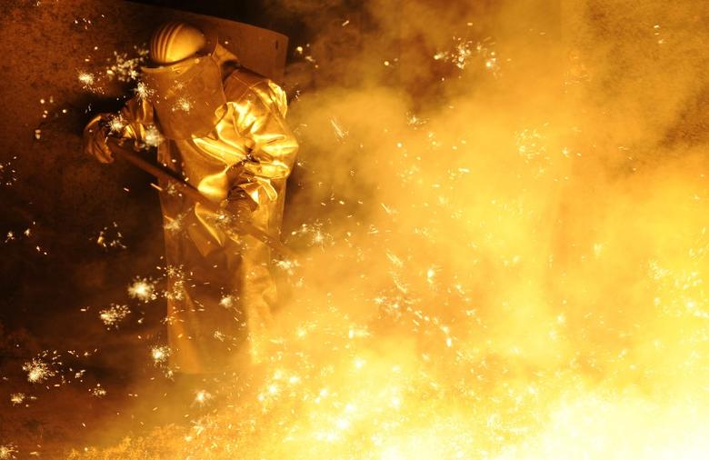 FILE PHOTO: A steel-worker is pictured at a furnace at the plant of a German steel company in Lower Saxony on November 10, 2011. REUTERS/Fabian Bimmer