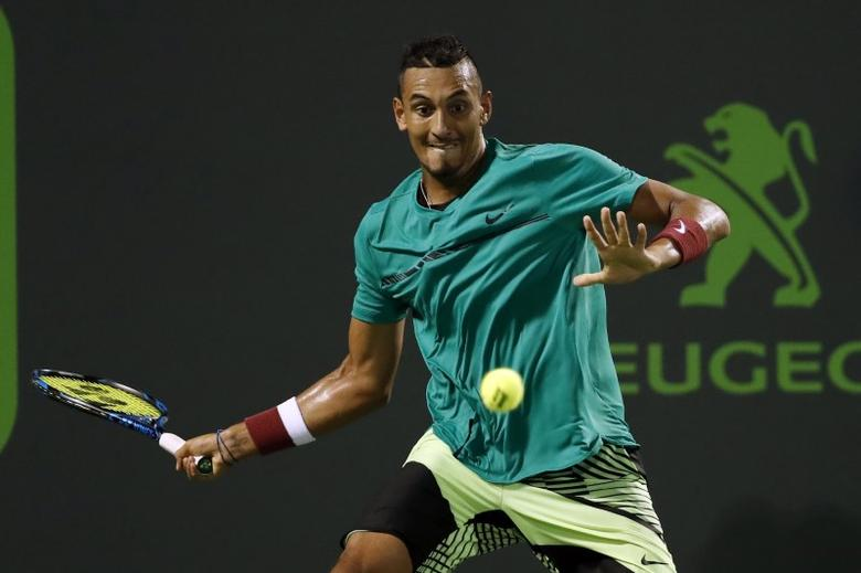 Mar 31, 2017; Miami, FL, USA; Nick Kyrgios of Australia hits a forehand against Roger Federer of Switzerland (not pictured) during a men's singles semi-final in the 2017 Miami Open at Brandon Park Tennis Center. Geoff Burke-USA TODAY Sports