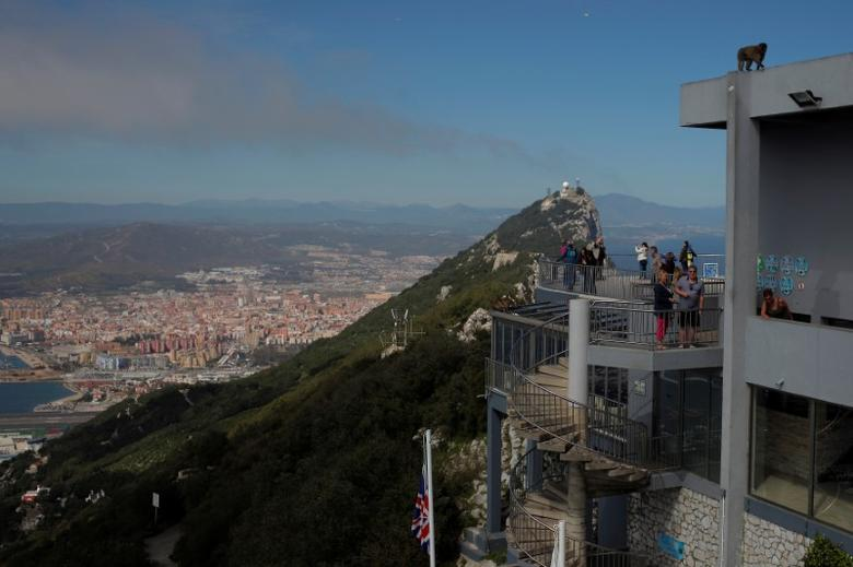 Tourists stand at a terrace on the top of the Rock in the British overseas territory of Gibraltar, historically claimed by Spain, March 29, 2017. REUTERS/Jon Nazca