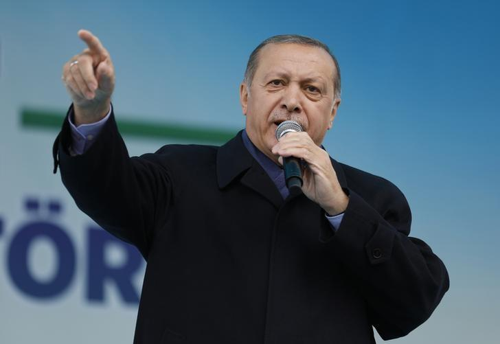 Turkish President Tayyip Erdogan addresses his supporters during a rally for the upcoming referendum in the Black Sea city of Rize, Turkey, April 3, 2017. REUTERS/Umit Bektas