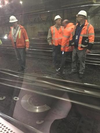 Emergency officials view scene where a New Jersey transit train derailed during rush hour at Penn Station, forcing passengers to be evacuated from cars in the second such incident at the midtown hub in less than two weeks, according to officials, in New York, April 3, 2017.    REUTERS/Suzanne Barlyn