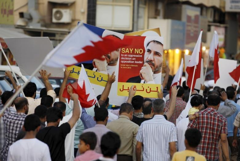 Protesters hold photos of Sheikh Ali Salman, Bahrain's main opposition leader and Secretary-General of Al-Wefaq Islamic Society, as they march asking for his release in the village of Jidhafs, west of Manama, in Bahrain June 16, 2015. REUTERS/Hamad I Mohammed/File Photo