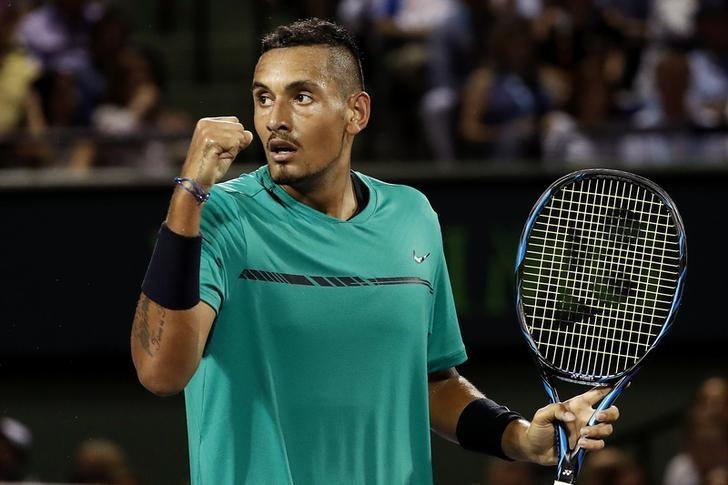Mar 31, 2017; Miami, FL, USA; Nick Kyrgios of Australia gestures after winning a point against Roger Federer of Switzerland (not pictured) during a men's singles semi-final in the 2017 Miami Open at Brandon Park Tennis Center.  Mandatory Credit: Geoff Burke-USA TODAY Sports